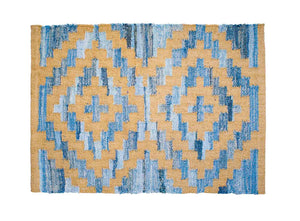 Coastal style upcycled denim blue and sustainable dark jute door mat in Aztec pattern.