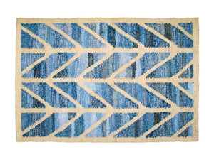 Coastal style upcycled denim blue and sustainable blonde jute door mat in herringbone pattern.