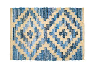 Coastal style upcycled denim blue and sustainable jute door mat in Aztec pattern.