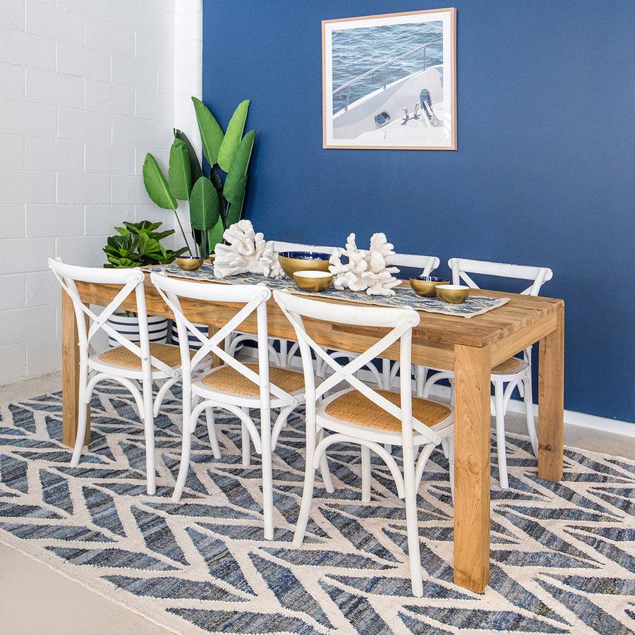 Coastal style upcycled denim blue and white cotton flatweave rug in herringbone pattern.