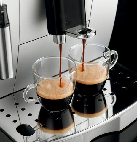 coffee being dispensed by a superautomatic erspresoo machine