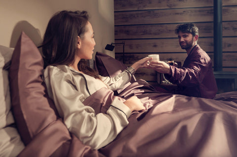 Couple in Bed drinking espresso