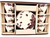 Boxed set of espresso cups showing coffee bean motif