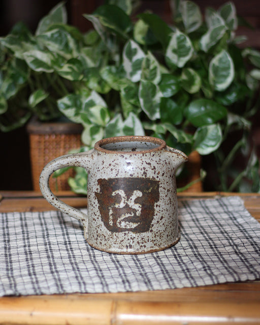 Ceramic Pitcher, Speckled with Abstract Symbol