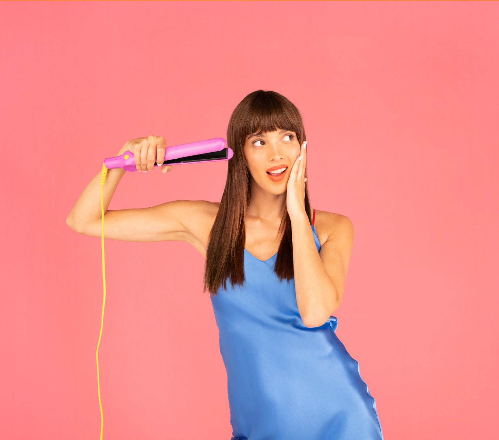 Woman with her hand on her face with the Styling Iron held up at her side