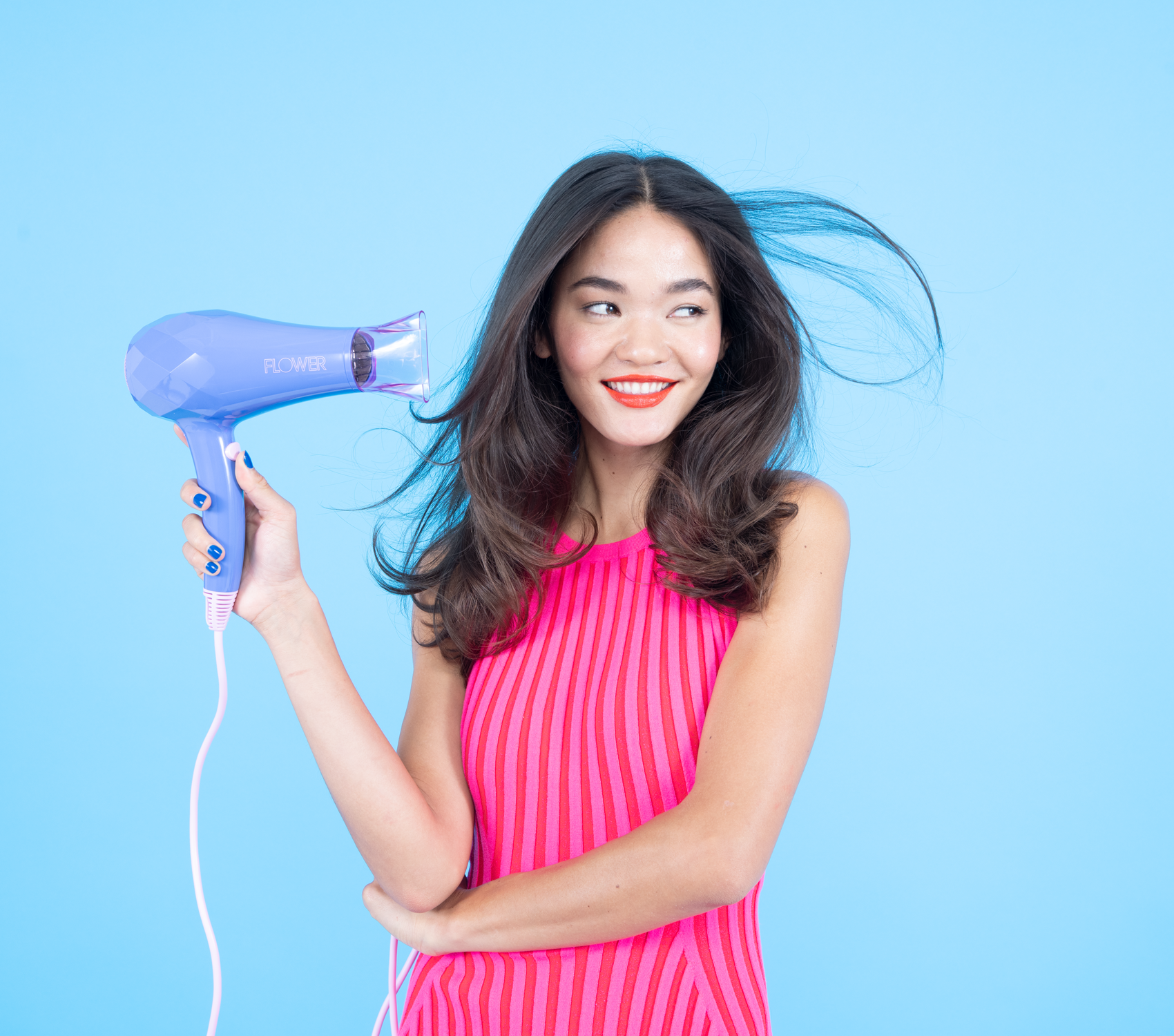 Woman blow drying her hair with Ionic Pro Dryer
