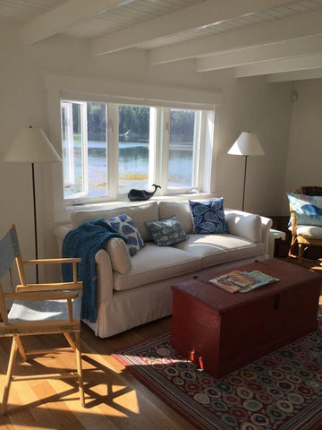 A customized sofa from our Condo Furniture Collection sitting pretty under a large window in Maine.