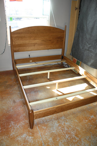 Amish made Kenton Arched Headboard Bed in Cherry or Maple showing four dovetailed lateral supports on Queen