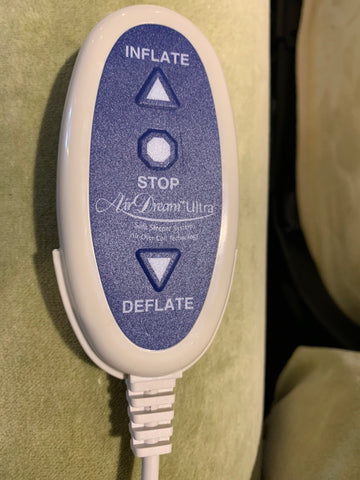 close up showing control wand for air dream sleep mattress on condo sized Douglas sleeper