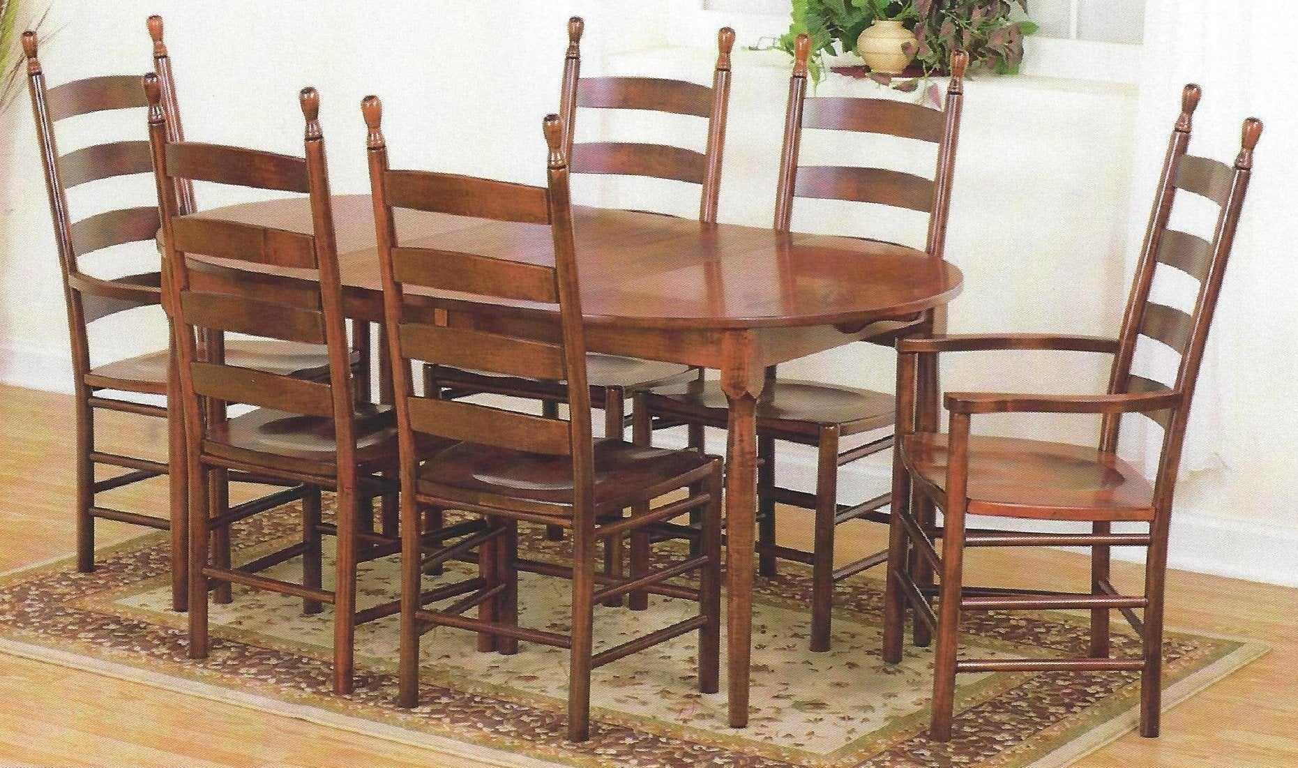 42 Round Extension Dining Table With Four Maple Chairs