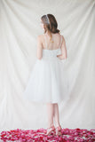 "This lace-trim, a-line dress is an elegant option for both brides and bridesmaids. Perfect for summer weddings, the simple gracefulness of The Claire Dress can be worn alone or be coordinated with a delicate capelet.  Adjustable straps  Fully lined with hidden back zipper  Falls approximately 24"" from natural waist  Steam or dry clean only"