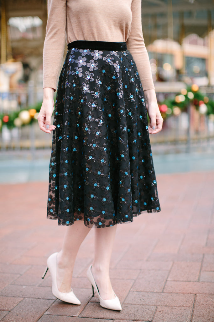 "This holiday season, the party starts here!  Our Meredith Sequin Midi Tulle Skirt is designed with our signature A-line silhouette, sprinkled with sequinned flowers and a luxurious velvet waist band.  We love to pair with a sweater or our matching Meredith sequin crop top for any holiday parties and new year festivities.      Fully lined with chiffon     All length is approximately 27""     Steam or dry clean only"