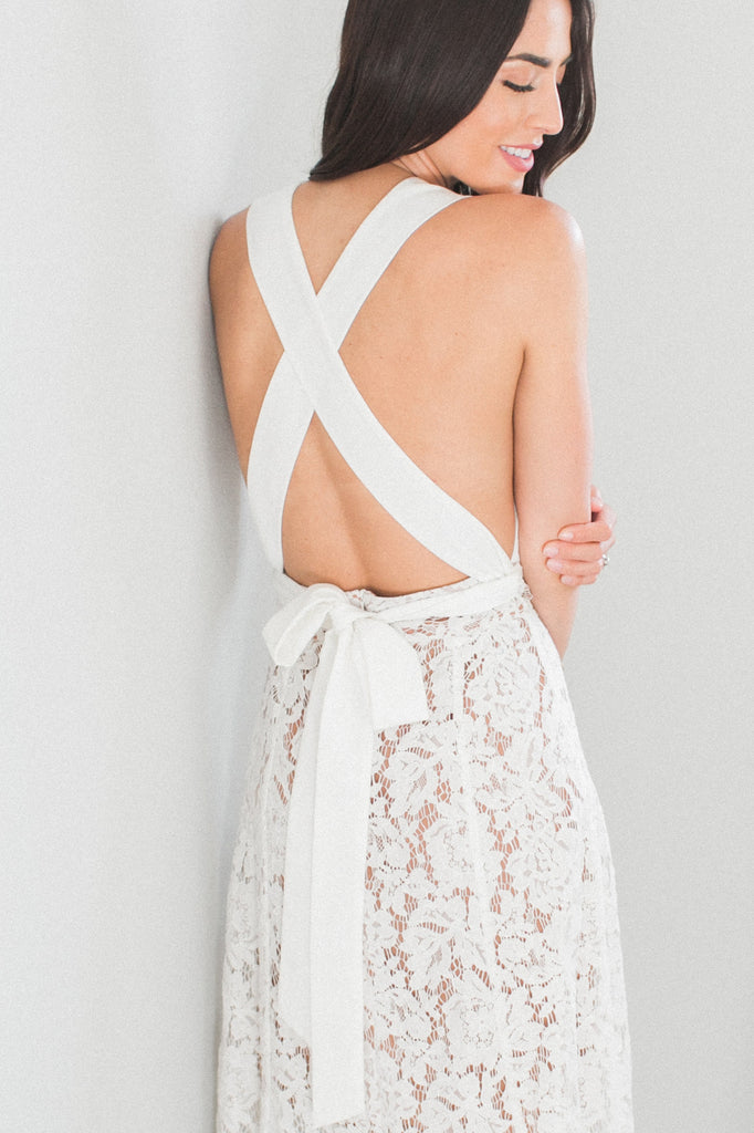Our Skye Halter Lace Dress is one feminine midi dress!  Designed on a soft floral lace, lined with nude and a low back, this dress is a must-have for your wedding festivities, whether it is a bridal shower, rehearsal dinner, and reception.  Straps designed to wear it multiple ways.    Zip back. Fully lined. Length 40 inches from strap.