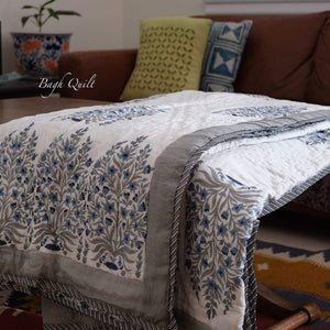 Bagh Quilt is hand block printed quilt which will fit Queen/King size bed. This quilt has cotton padding for comfort and warmth for all seasons.