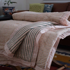 Heera quilt is hand block printed queen/king size quilt. This quilt is a contemporary pattern of  stripes.