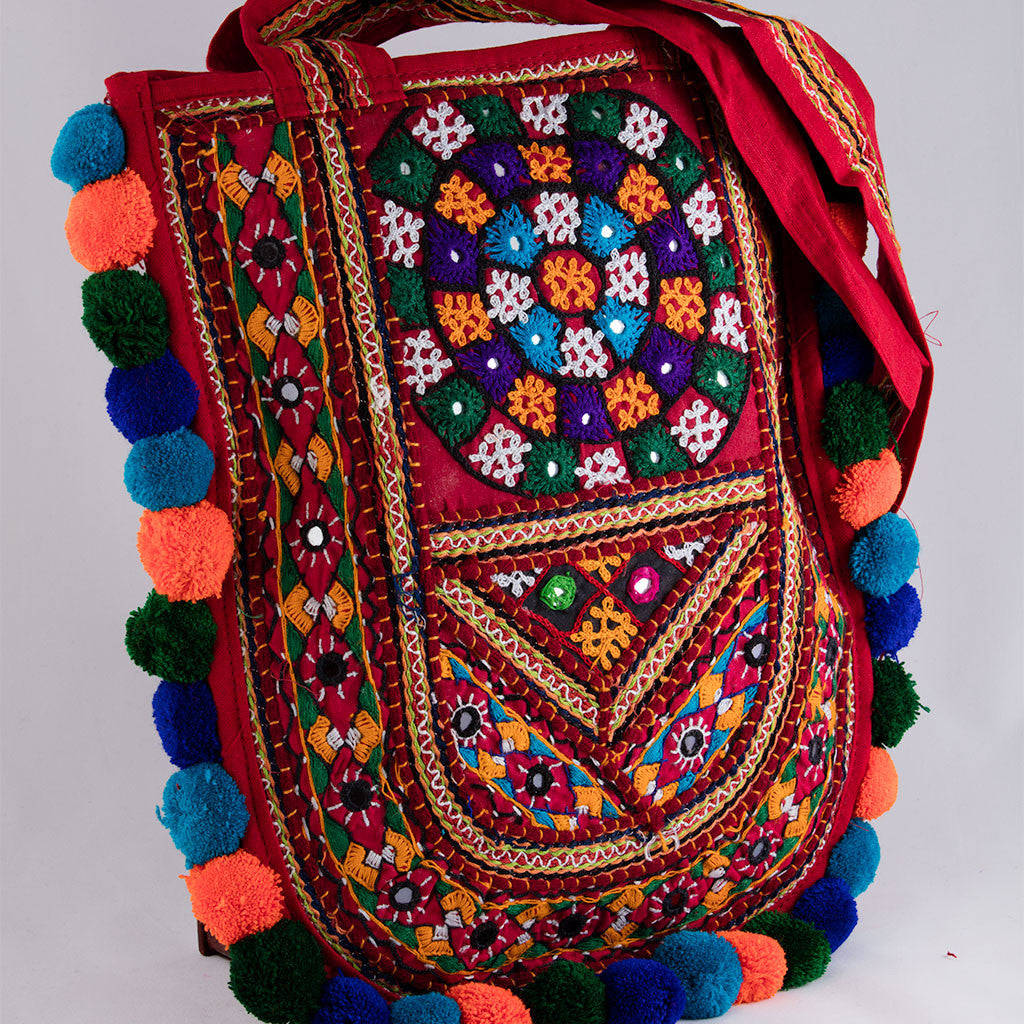 Deep Banjara Kutchi embroidered pompom Handbag