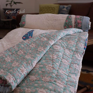 Kamala quilt is queen size hand block printed quilt. This quilt has cotton padding for comfort and warmth.
