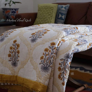 Mustard Floral quilt / rajai is a queen/ king size handmade lightweight and hand block printed. This mustard and grey combination floral quilt will add charm character and luxury to your bedroom.