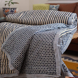 Neela quilt /rajai is modern queen / king size handmade, lightweight and hand block printed. This is a reversible quilt having a beautiful stripe pattern in royal blue colour on one side and diamond pattern on the other.