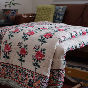 Queen / King size reversible quit has a beautiful rose pattern with royal red and rich green colours. It has luxurious feel and adds colourfulness to any interiors.