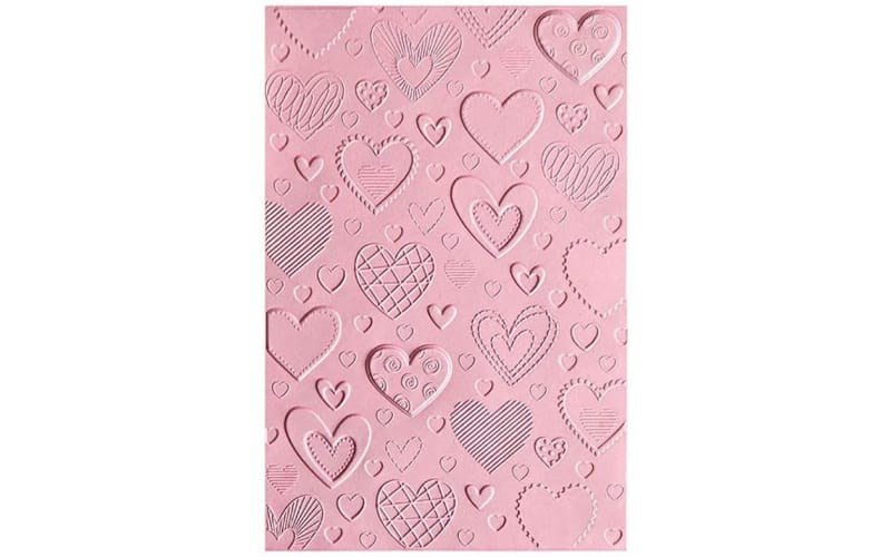 Sizzix 3D Hearts embossing folder on pink material