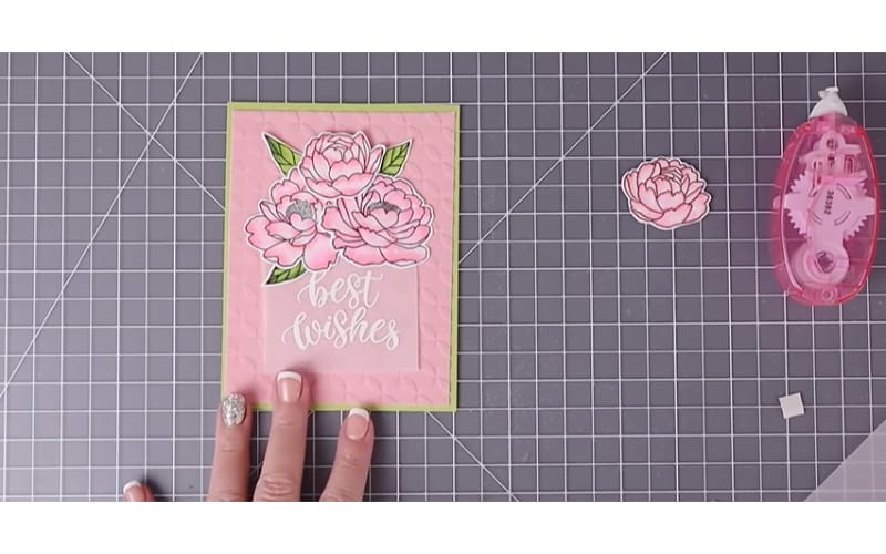 finished card made from embossed flocked cardstock on a cutting mat