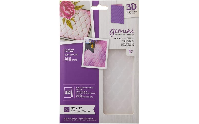 The Gemini Studded Leather Embossing Folder in its original purple packaging with a transparent window