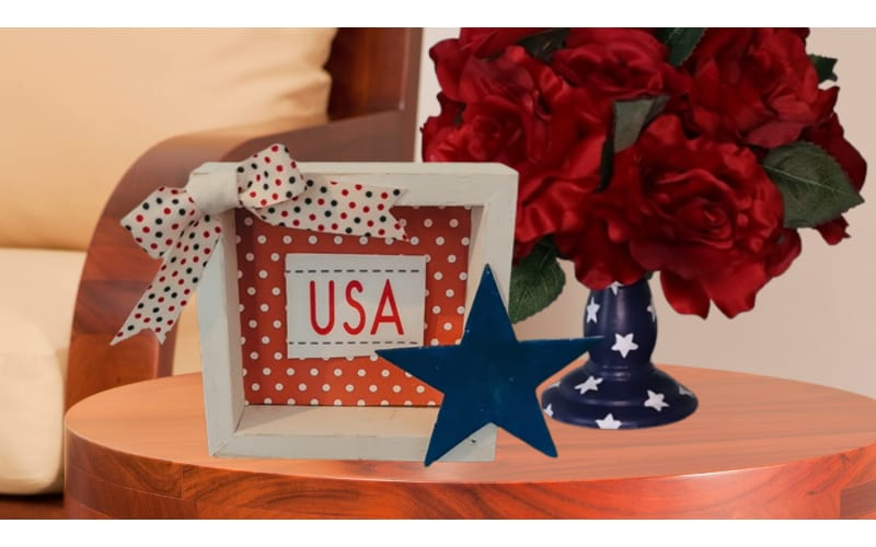 USA shadowbox and rose topiary on a wooden side table