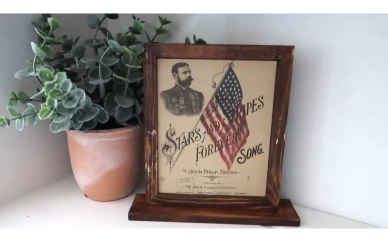 Stars and Stripes Forever Song printout in a double-sided sign stand