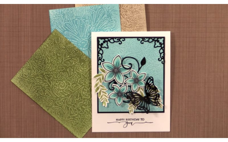 card backgrounds made from wax paper embossing and a finished card