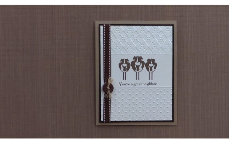 a card made by embossing with two different embossing folders and stamped with cow and sentiment stamps