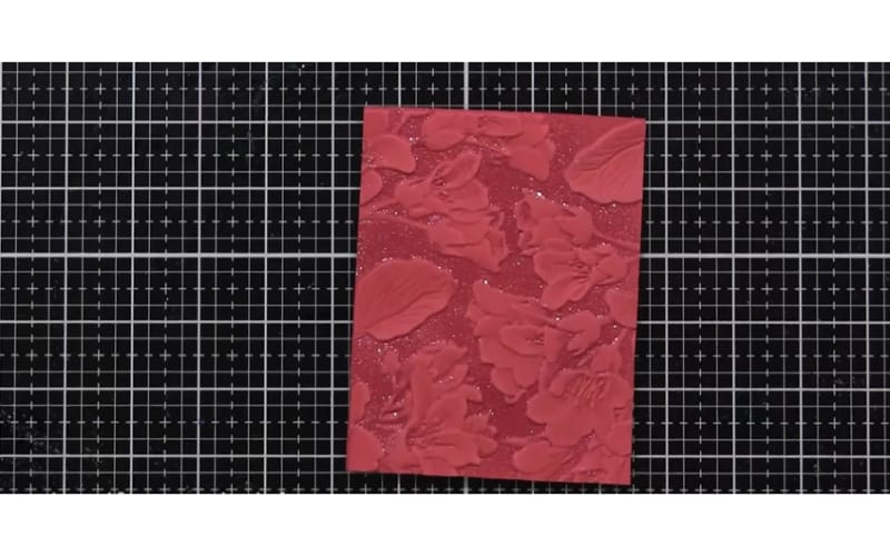 tone-on-tone embossed card on top of a cutting mat