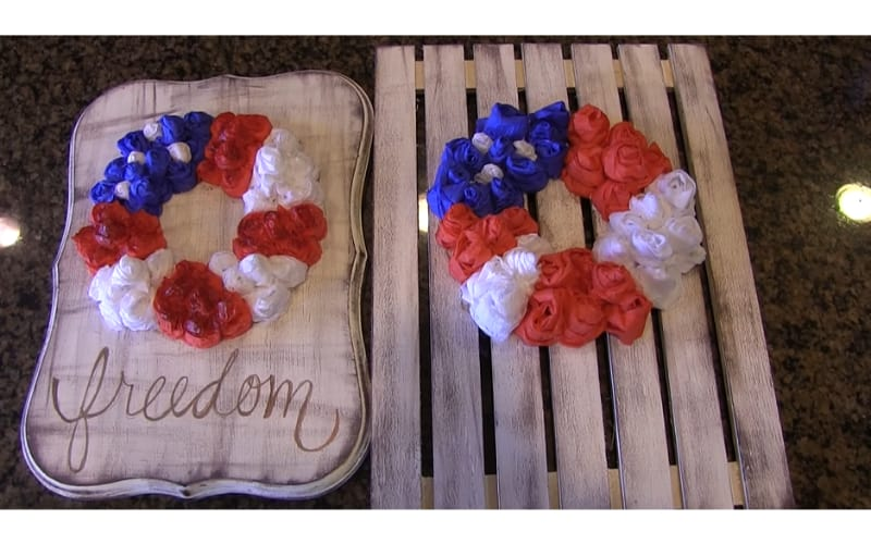 A rose wreath on distressed wooden boards