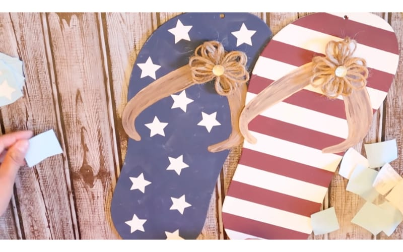 cardboard slippers painted with patriotic colors and decorated with hemp rope bows