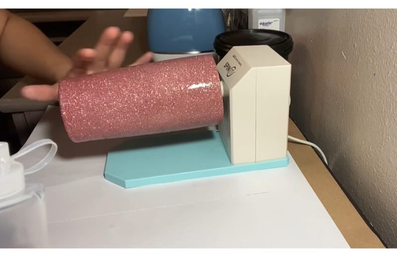 Applying CrystaLac as one of the alternatives on how to glitter a tumbler without epoxy