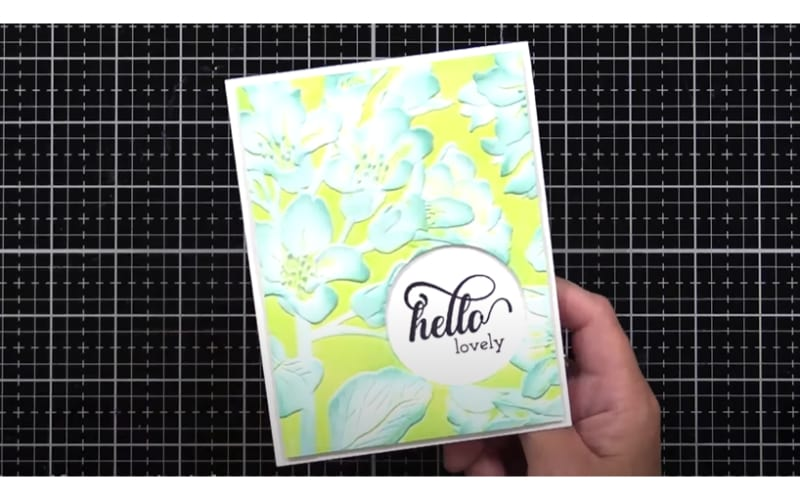 colored background embossing technique and inked embossed flowers