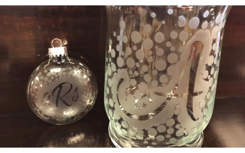 an etched Christmas ornament and vase