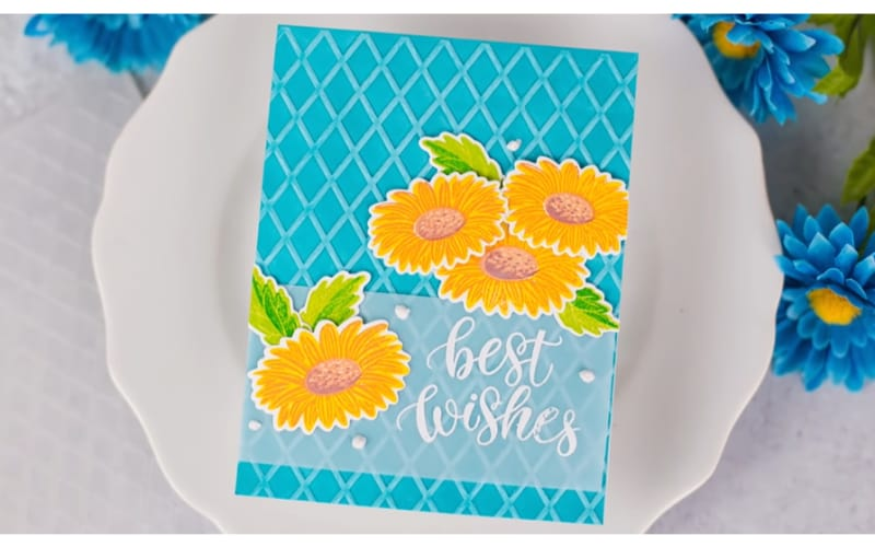 a finished card made from embossed cardstock with colorful daisies