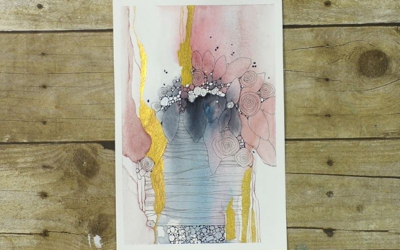 A watercolor abstract with gold paint and doodle details