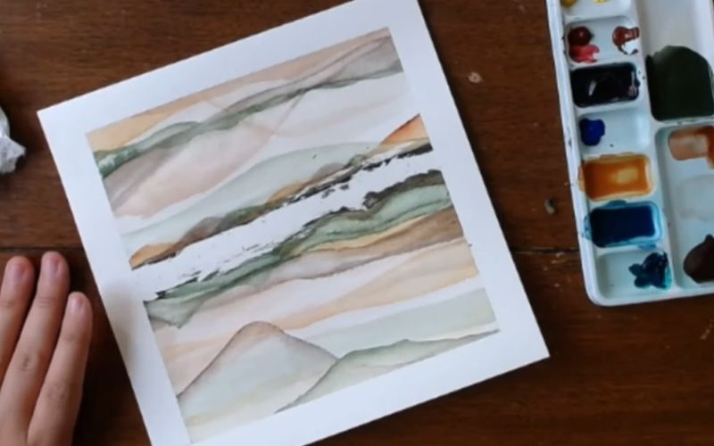 Abstract painting of a mountain scene done in watercolor