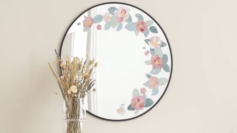 Circular mirror painted with flowers