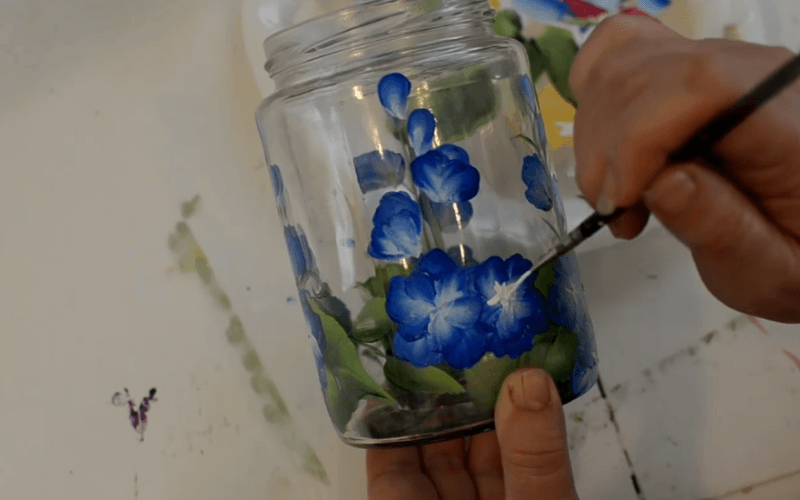 Painting glowers on recycled glass - Image by Pamela Gropp