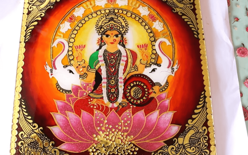 Tanjore style painting of a woman sitting on a lotus - Image by Creative Cat