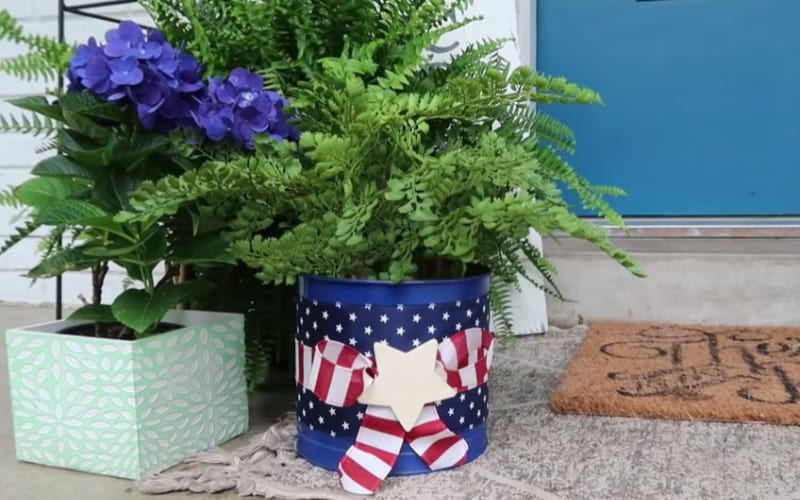 A cookie can made into a patriotic flower pot for patio displays