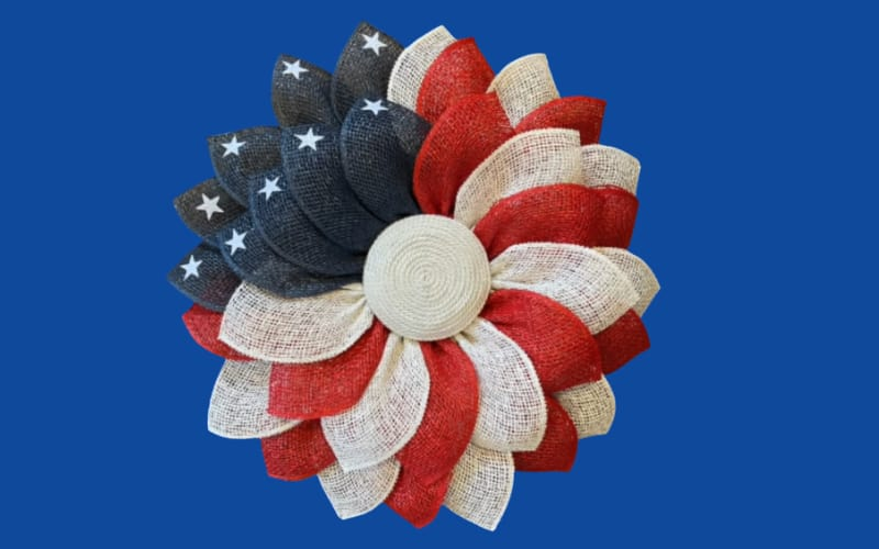 a patriotic flower wreath made from burlap