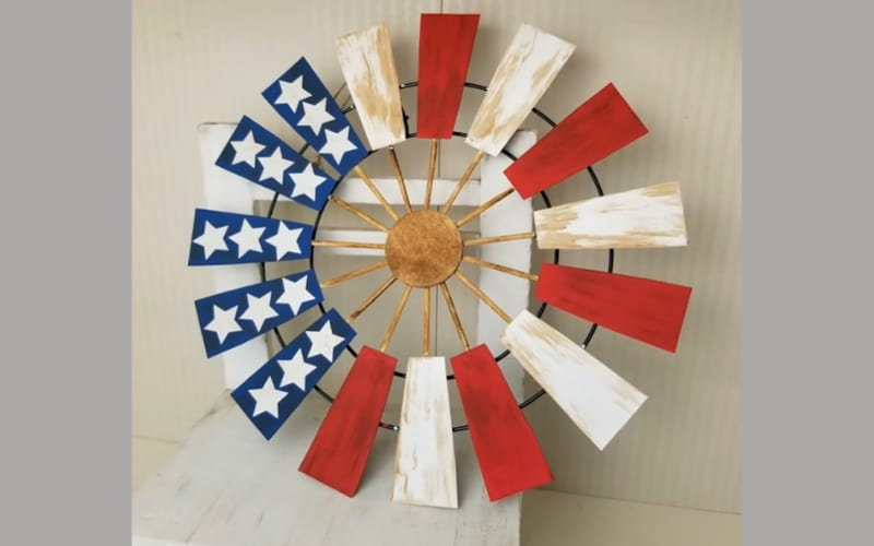 a patriotic windmill blade on a chair