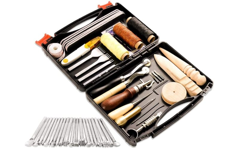 a set of embossing, sewing, and finishing tools in a black tool case