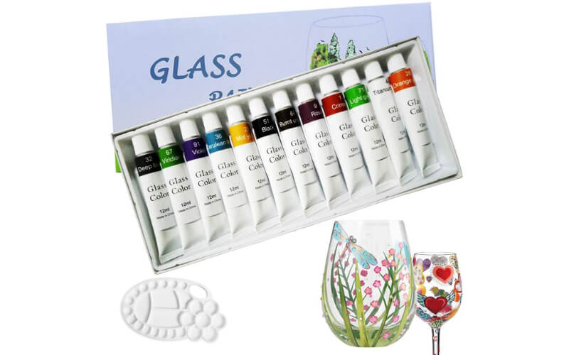 a set of glass paints and painted wine glasses