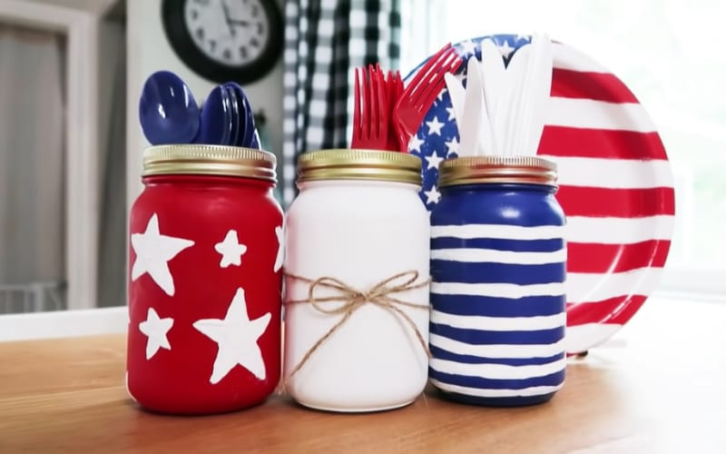 a trio of mason jars filled with plastic cutlery
