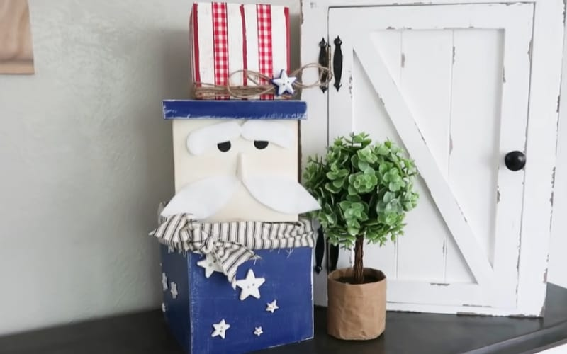 a trio of nesting boxes stacked to form an Uncle Sam decor